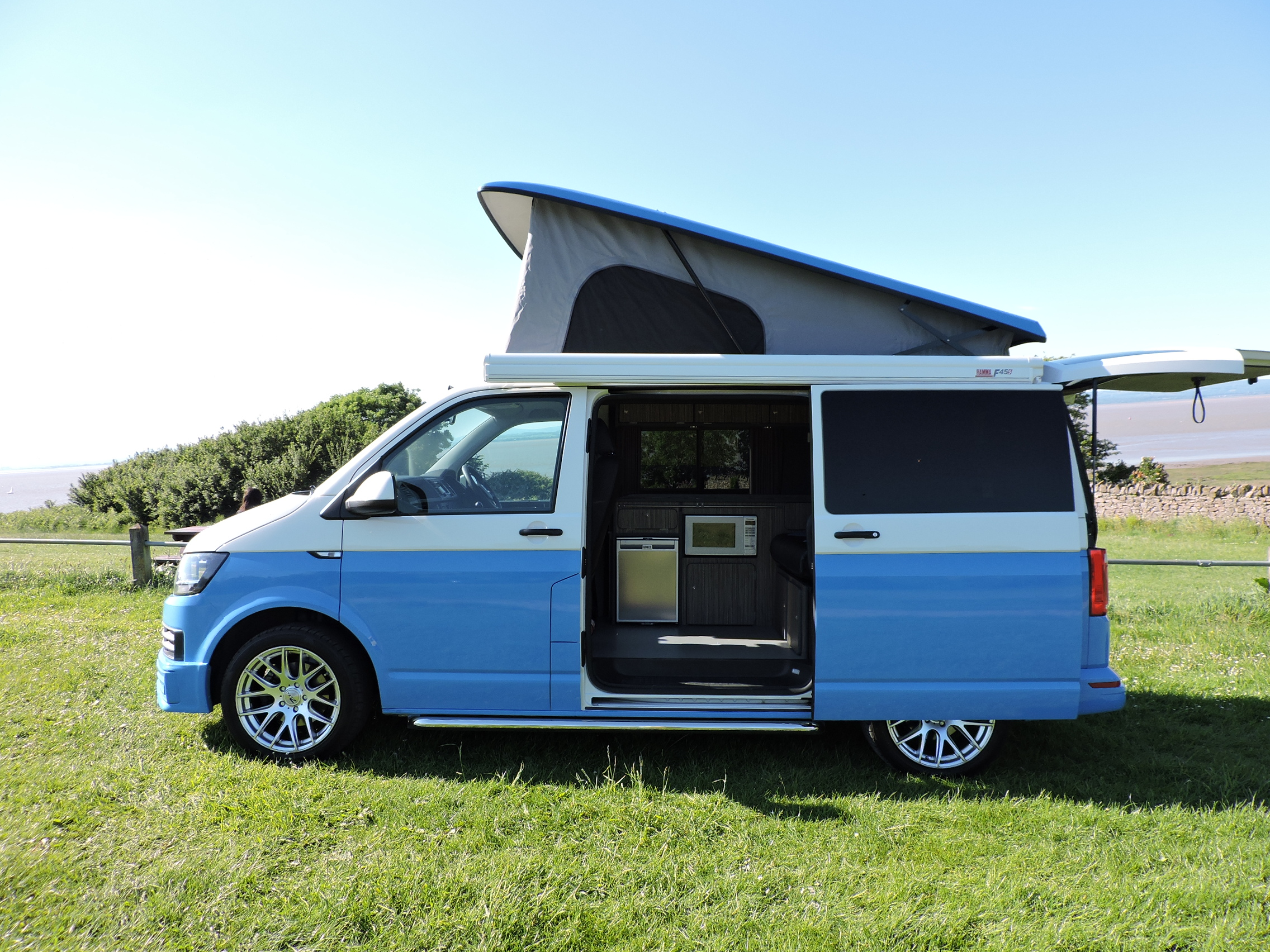 Blue pop top campervan